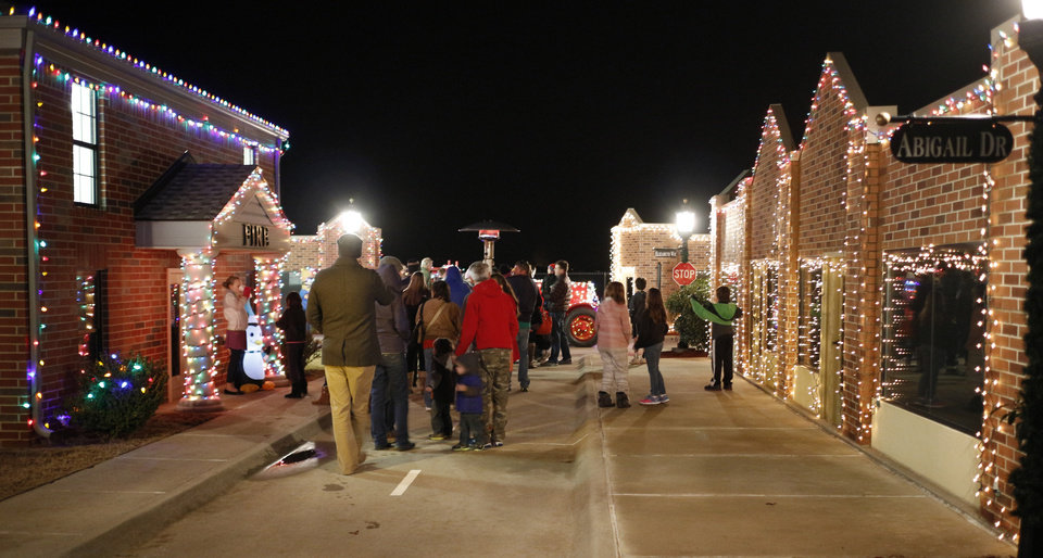 Photo -  Families explore the Edmond Fire Department's Children's Safety Village during Winter Night. PHOTO BY DOUG HOKE, THE OKLAHOMAN   DOUG HOKE -