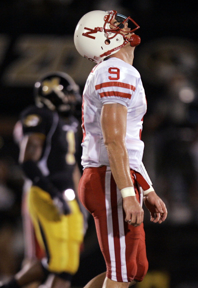 Photo - Nebraska quarterback Sam Keller reacts as he walks off the field after throwing and interception during the third quarter of a college football game against Missouri Saturday, Oct. 6, 2007, in Columbia, Mo. Missouri scored on the ensuing drive. (AP Photo/Jeff Roberson) ORG XMIT: MOJR116
