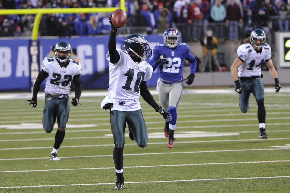 Photo - FILE - In this Dec. 19, 2010, file photo, Philadelphia Eagles' DeSean Jackson returns a punt for a touchdown during the fourth quarter of the NFL football game against the New York Giants in East Rutherford, N.J. The Eagles won 38-31. The Eagles have enjoyed some of their greatest moments on the road against the Giants. Chip Kelly, the Eagles' coach, certainly doesn't need a refresher course before Sunday's game between the two struggling teams. He knows Philadelphia (1-3) and New York (0-4) go back a long way. (AP Photo/Bill Kostroun, File)