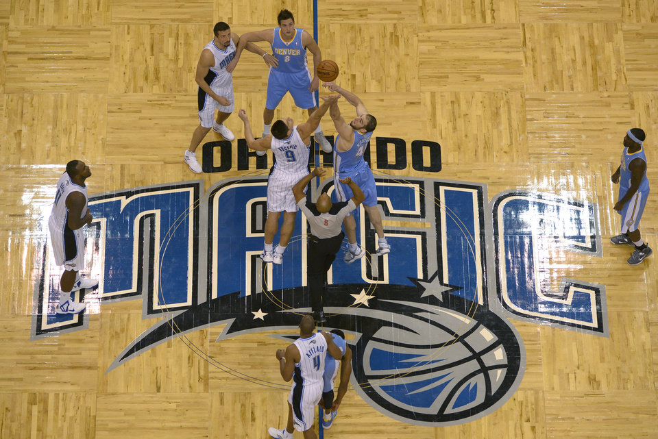Orlando Magic center Nikola Vucevic (9), of Montenegro, and Denver Nuggets center Kosta Koufos (41) battle for the opening tip-off during the first half of an NBA basketball game in Orlando, Fla., Friday, Nov. 2, 2012. (AP Photo/Phelan M. Ebenhack)