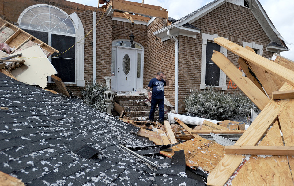 Photo -   Charles Kellogg walks away from his destroyed house after severe weather hit the Eagle Point subdivision in Limestone County, Ala. on Friday, March 2, 2012. A reported tornado destroyed several houses in northern Alabama as storms threatened more twisters across the region Friday (AP Photo/The Decatur Daily, Jeronimo Nisa)