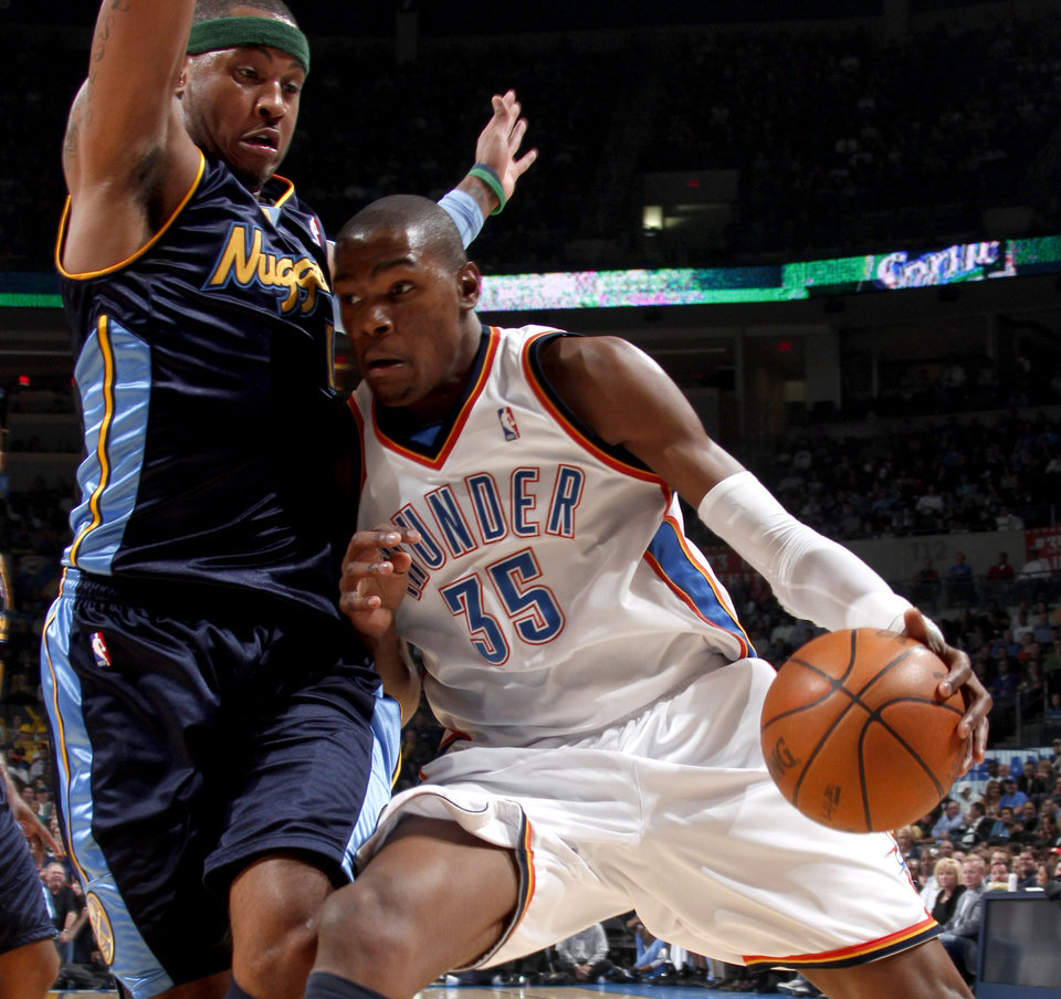 Photo - Oklahoma City's Kevin Durant tries to get past Denver's Carmelo Anthony during the NBA basketball game between the Oklahoma City Thunder and the Denver Nuggets at the Ford Center in Oklahoma City, Wednesday, April 7, 2010.  Photo by Bryan Terry, The Oklahoman ORG XMIT: KOD