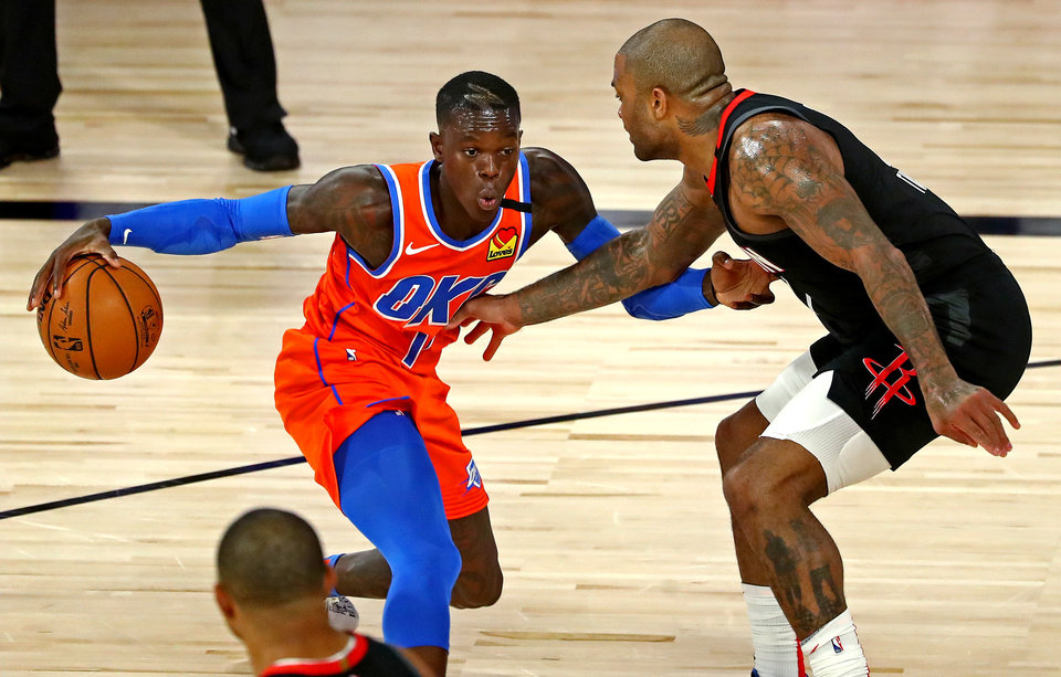 Photo - Aug 29, 2020; Lake Buena Vista, Florida, USA; Oklahoma City Thunder guard Dennis Schroder (17) drives to the basket against Houston Rockets forward P.J. Tucker (17) during the second quarter in game five of the first round of the 2020 NBA Playoffs at The Field House. Mandatory Credit: Kim Klement-USA TODAY Sports