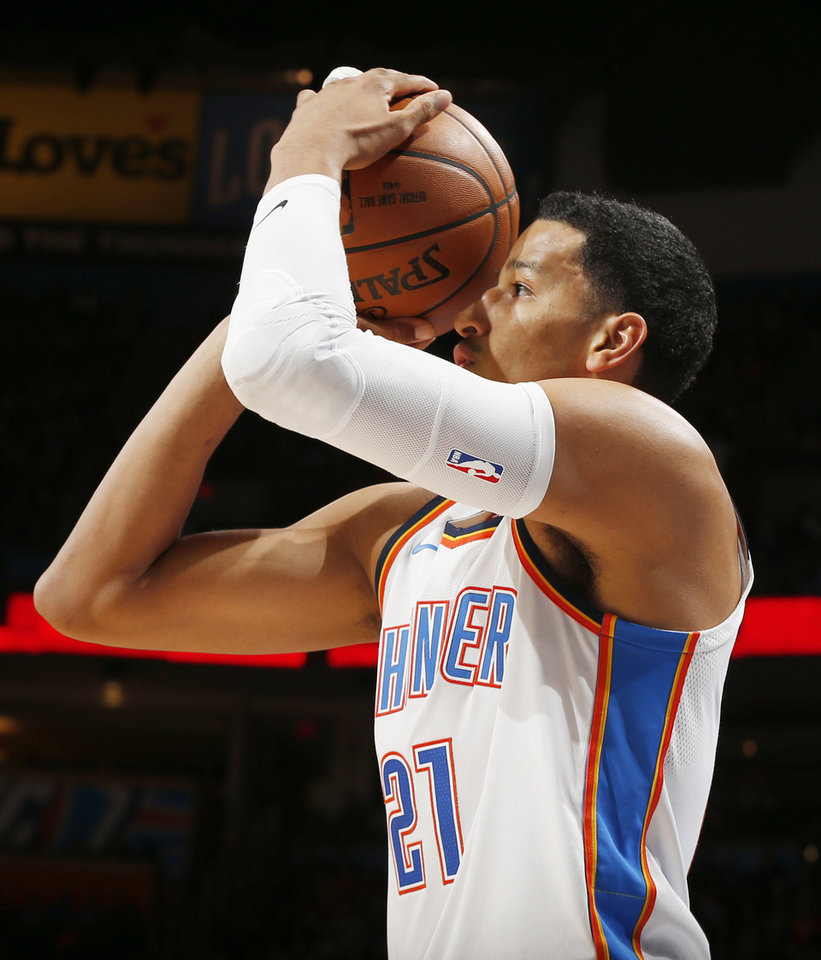 Photo - Oklahoma City's Andre Roberson (21) takes a shot during an NBA basketball game between the Oklahoma City Thunder and the Minnesota Timberwolves at Chesapeake Energy Arena in Oklahoma City, Sunday, Oct. 22, 2017. Photo by Nate Billings, The Oklahoman