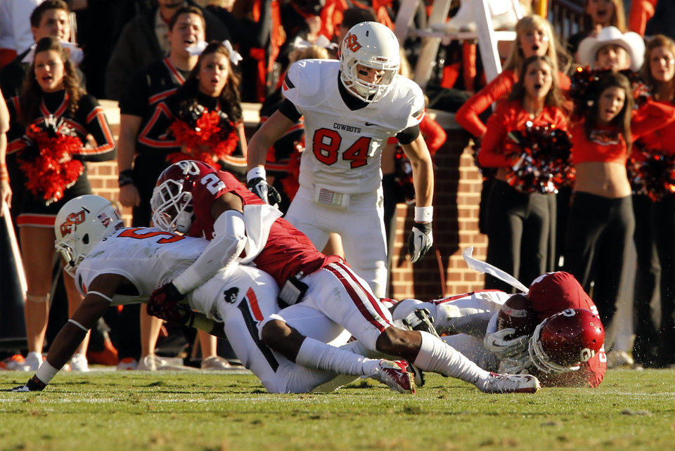 Photo - Oklahoma's Lamar Harris (15) intercepts a pass intended for Oklahoma State's Josh Stewart (5) during the Bedlam college football game between the University of Oklahoma Sooners (OU) and the Oklahoma State University Cowboys (OSU) at Gaylord Family-Oklahoma Memorial Stadium in Norman, Okla., Saturday, Nov. 24, 2012. Photo by Steve Sisney, The Oklahoman