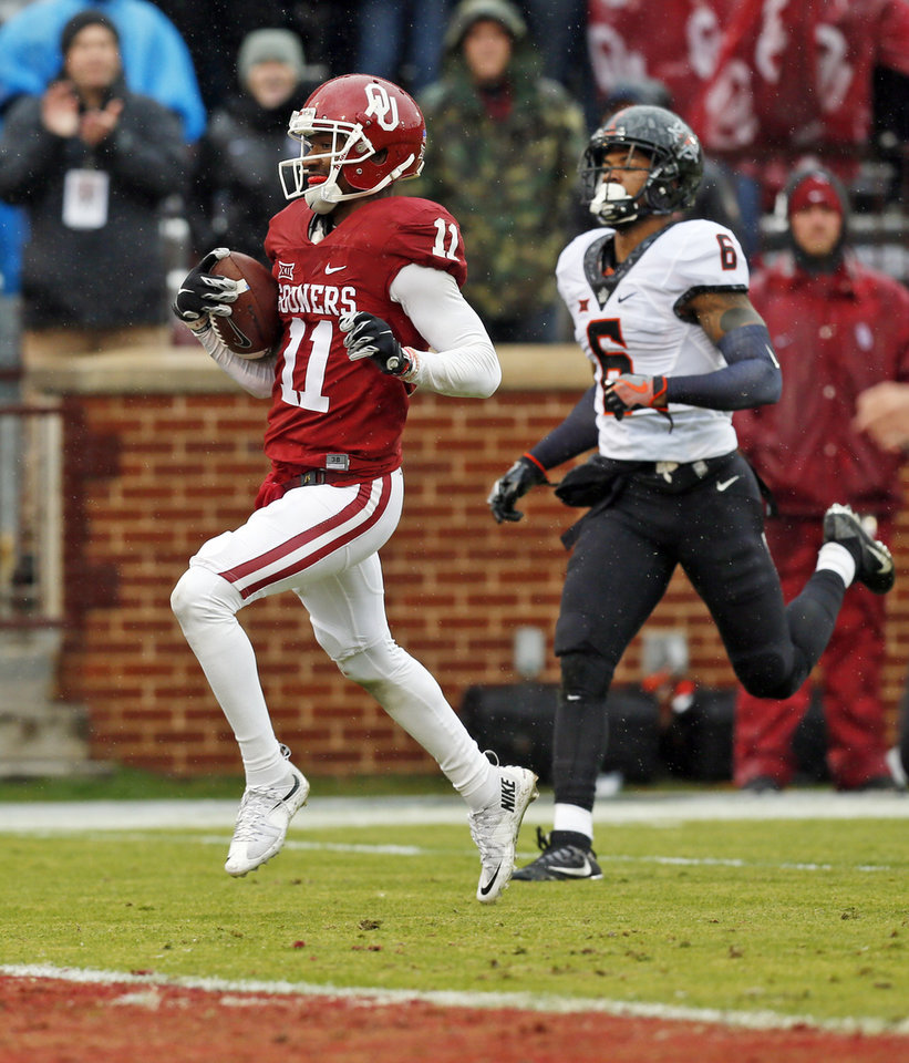 Photo - Oklahoma's Dede Westbrook (11) scores a touchdown in front of Oklahoma State's Ashton Lampkin (6) in the second quarter during the Bedlam college football game between the Oklahoma Sooners (OU) and the Oklahoma State Cowboys (OSU) at Gaylord Family - Oklahoma Memorial Stadium in Norman, Okla., Saturday, Dec. 3, 2016. Photo by Nate Billings, The Oklahoman