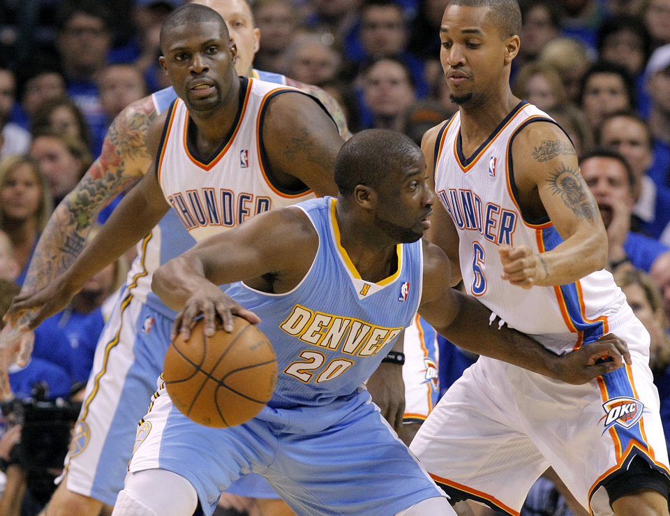 Photo - Oklahoma City's Nazr Mohammed (8) and Oklahoma City's Eric Maynor (6) defend on Denver's Raymond Felton (20) during the first round NBA playoff game between the Oklahoma City Thunder and the Denver Nuggets on Sunday, April 17, 2011, in Oklahoma City, Okla. Photo by Chris Landsberger, The Oklahoman