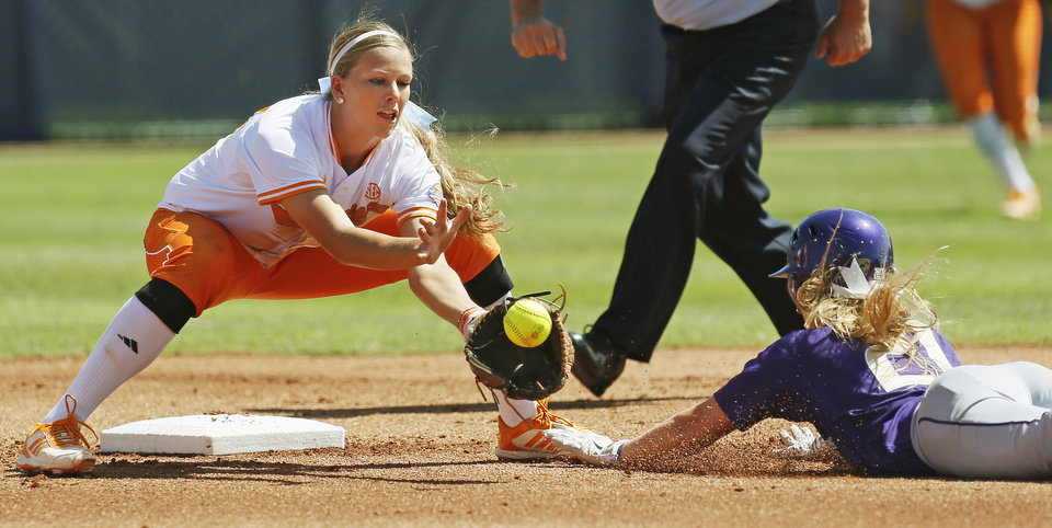 Washington's Victoria Hayward (21) is caught stealing second base by Tennessee's Madison Shipman (44) in the first inning during an NCAA softball game in the Women's College World Series between Washington and Tennessee at ASA Hall of Fame Stadium in Oklahoma City, Saturday, June 1, 2013. Tennessee won 1-0. Photo by Nate Billings, The Oklahoman