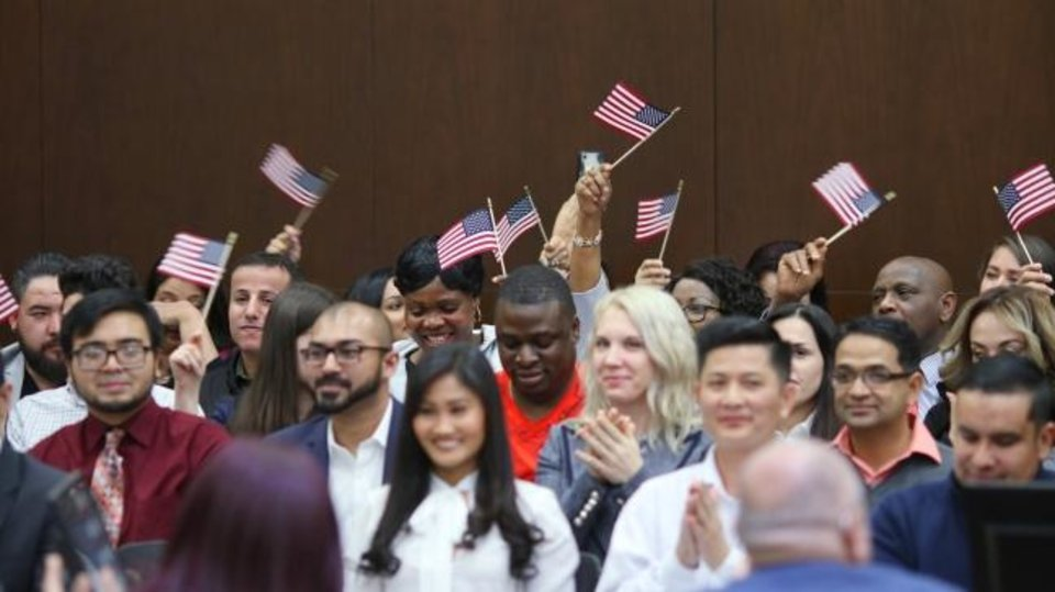 Photo -  Naturalization ceremony at the District Court for the Western District of Oklahoma, Friday, February 28, 2020.  [Photo by Doug Hoke/The Oklahoman]