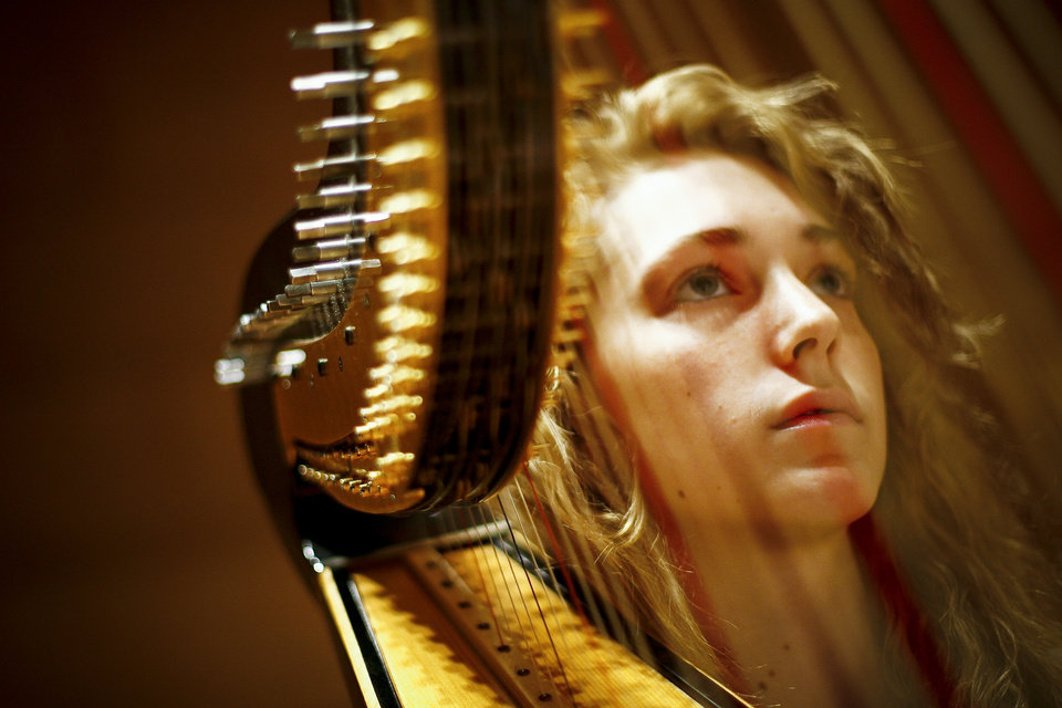 Photo - Olivia Harp, 16, from Tulsa sits next to her harp as the director gives instructions in an orchestra practice during the Oklahoma Summer Arts Institute at Quartz Mountain Arts and Conference Center near Lone Wolf on Wednesday, June 15, 2011. Photo by Zach Gray, The Oklahoman ORG XMIT: KOD