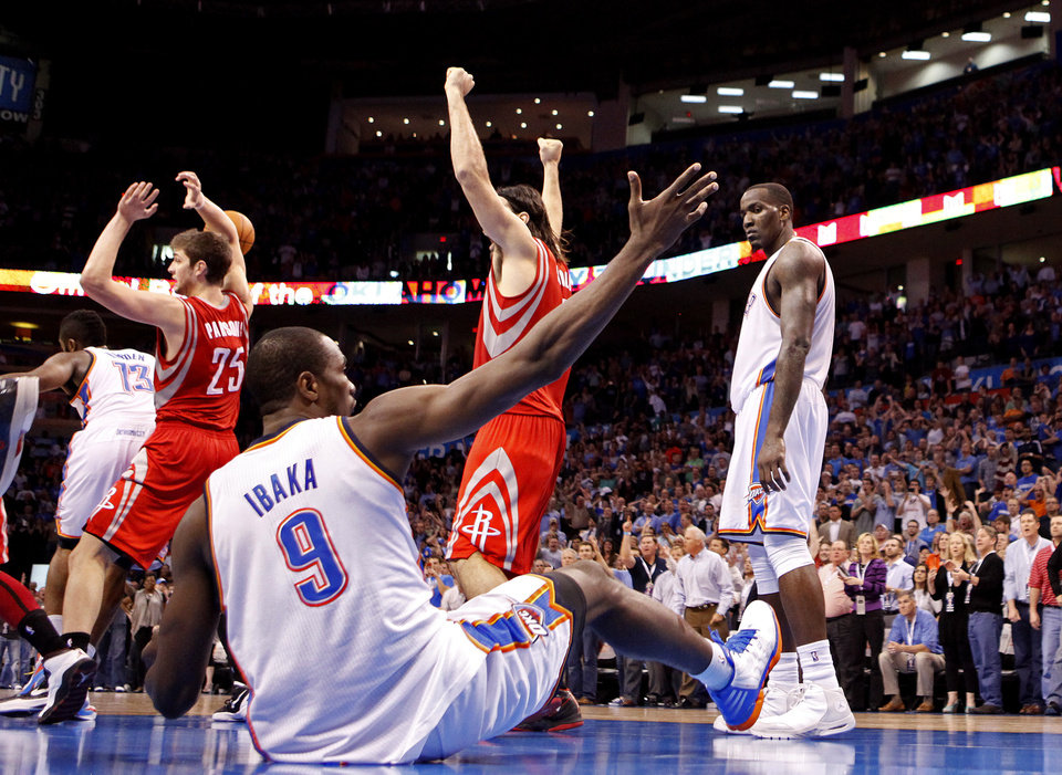 Oklahoma City's Serge Ibaka (9) argues for a foul after missing a last -second shot as Houston's Chandler Parsons (25) and Luis Scola (4) celebrate during the NBA basketball game between the Oklahoma City Thunder and the Houston Rockets at the Chesapeake Energy Arena, Tuesday, March 13, 2012. Photo by Sarah Phipps, The Oklahoman.