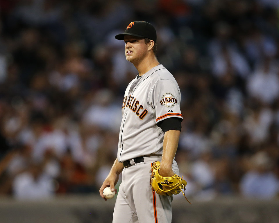 Photo - San Francisco Giants starting pitcher Matt Cain reacts after giving up 3 runs during the fourth inning of a baseball game against the Chicago White Sox on Tuesday, June 17, 2014, in Chicago. (AP Photo/Andrew A. Nelles)