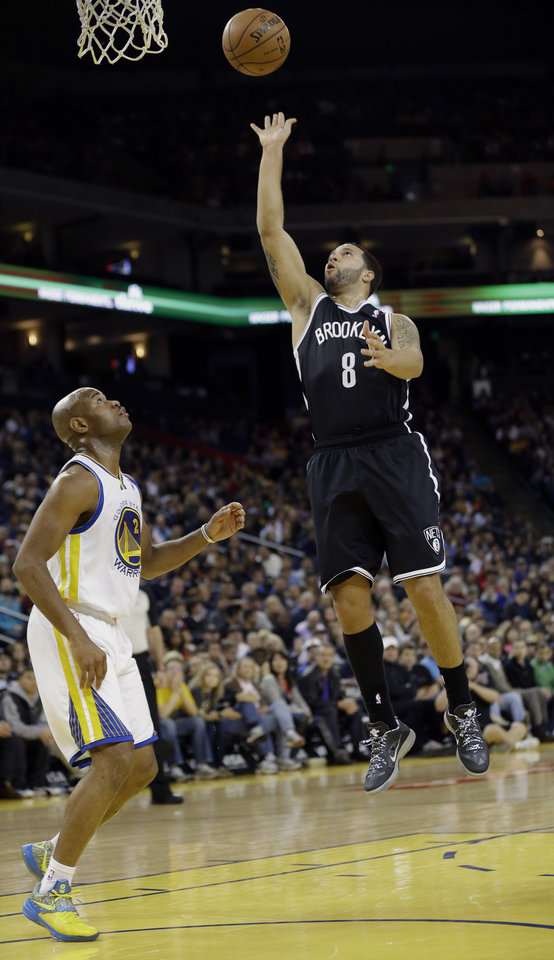 Photo -   Brooklyn Nets' Deron Williams (8) scores next to Golden State Warriors' Jarrett Jack (2) during the first half of an NBA basketball game in Oakland, Calif., Wednesday, Nov. 21, 2012. (AP Photo/Marcio Jose Sanchez)
