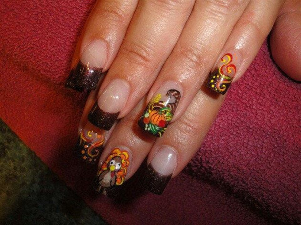 Photo - Holiday decorations don't have to be limited to your home decor. Terri Jacobs pinned her holiday nail art on Pinterest to inspire others to add some festivity to their nails. Photo provided.