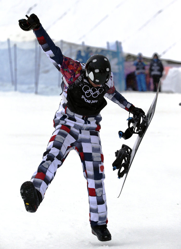 Photo - Russia's Nikolai Olyunin dances after winning the men's snowboard cross semifinal at the Rosa Khutor Extreme Park, at the 2014 Winter Olympics, Tuesday, Feb. 18, 2014, in Krasnaya Polyana, Russia. (AP Photo/Andy Wong)