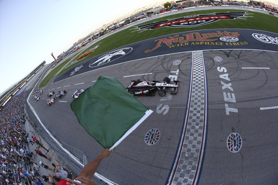 Photo - In a photo provided by IndyCar, Will Power, of Australia, takes the green at the start of the IndyCar auto race at Texas Motor Speedway in Fort Worth, Texas, Saturday, June 7, 2014. (AP Photo/IndyCar, Jonathan Ferry)