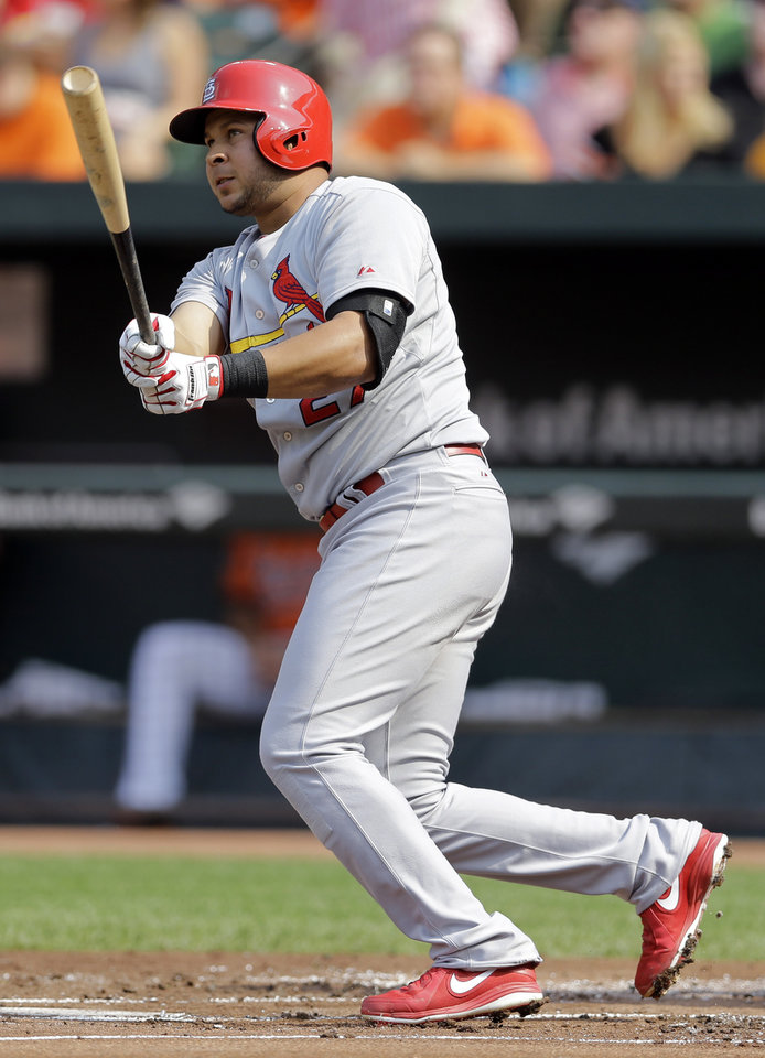 Photo - St. Louis Cardinals' Jhonny Peralta doubles in the first inning of an interleague baseball game against the Baltimore Orioles, Saturday, Aug. 9, 2014, in Baltimore. Matt Carpenter scored on the play. (AP Photo/Patrick Semansky)