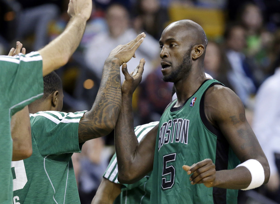 Boston Celtics center Kevin Garnett (5) receives congratulations from teammates as he walks to the bench during the fourth quarter of an NBA basketball game against the Toronto Raptors in Boston, Wednesday, March 13, 2013. Garnett scored 12 points, passing Jerry West for 15th on the NBA\'s career scoring list. The Celtics won 112-88. (AP Photo/Elise Amendola)