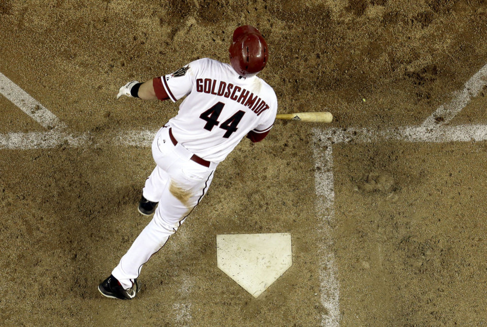 Photo - Arizona Diamondbacks' Paul Goldschmidt follows through on an two RBI double against the Washington Nationals during the fifth inning of a baseball game on Tuesday, May 13, 2014, in Phoenix. (AP Photo/Matt York)