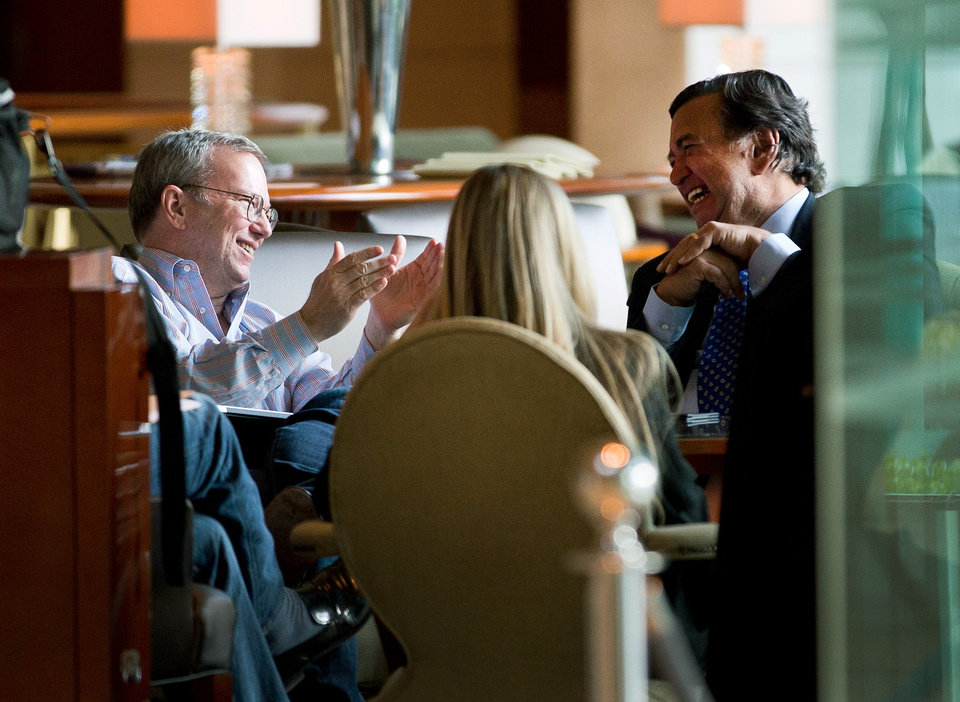 Photo - Google's executive chairman Eric Schmidt, right, chats with former New Mexico Gov. Bill Richardson, right, during their meeting at a hotel in Beijing Monday, Jan. 7, 2013. Schmidt, who is part of a delegation led by Richardson, is scheduled to leave Monday on a commercial flight bound for North Korea, a country considered to have the world's most restrictive Internet policies. (AP Photo/Andy Wong)