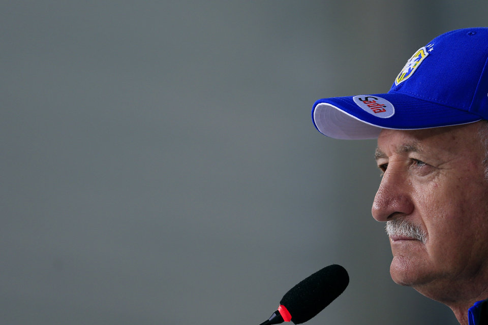 Photo - Brazil's coach Luiz Felipe Scolari listens to question during a press conference at the Granja Comary training center in Teresopolis, Brazil, Thursday, June 5, 2014. Brazil will face Croatia at the opening match of the World Cup soccer tournament on June 12. (AP Photo/Hassan Ammar)