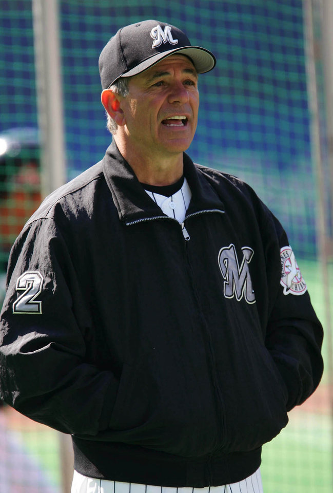 Photo - Lotte Marines manager Bobby Valentine watch his team's practice prior to their Pacific League season opener against Tohoku Rakuten Golden Eagles, Japan's first expansion team in 50 years, at Chiba Marine Stadium in Chiba, east of Tokyo, Saturday, March 26, 2005.
