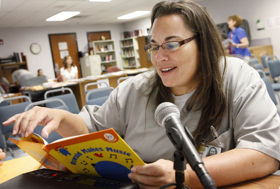 Penny Willoughby records a book for her children July 16 at Mabel Bassett Correctional Facility in McLoud. Through the prison�s Mommy and Me program, some prisoners� children receive CDs of their mothers reading to them. Photos By David McDaniel, The Oklahoman