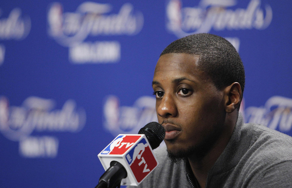 Miami Heat point guard Mario Chalmers answers a question during a news conference after Game 4 of the NBA finals basketball series against the Oklahoma City Thunder, Wednesday, June 20, 2012, in Miami. The Heat won 104-98. (AP Photo/Lynne Sladky)  ORG XMIT: NBA189