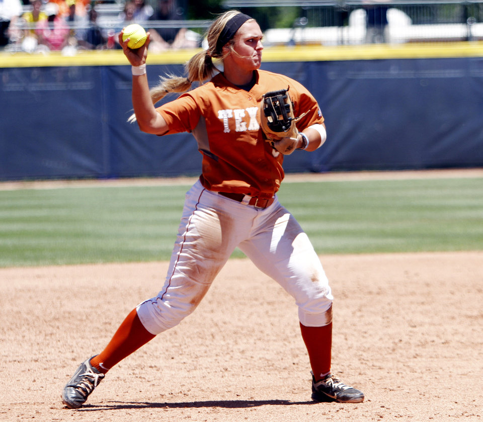 Photo - Texas third baseman Taylor Hoagland throws to first base after fielding a ground ball in the Women's College World Series elimination game versus Florida. The Longhorns would go on to win 3-0. Photo by KT KING, The Oklahoman