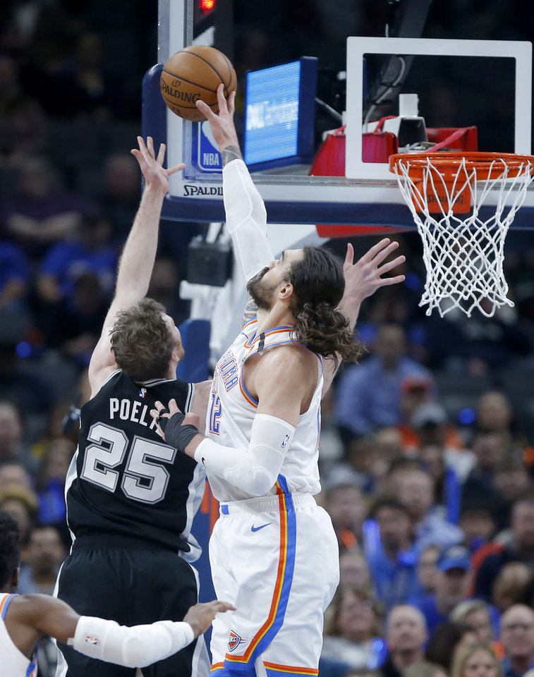 Photo - Oklahoma City's Steven Adams (12) blocks the shot of San Antonio's Jakob Poeltl (25) during an NBA basketball game between the Oklahoma City Thunder and the San Antonio Spurs at Chesapeake Energy Arena in Oklahoma City, Tuesday, Feb. 11, 2020. [Bryan Terry/The Oklahoman]