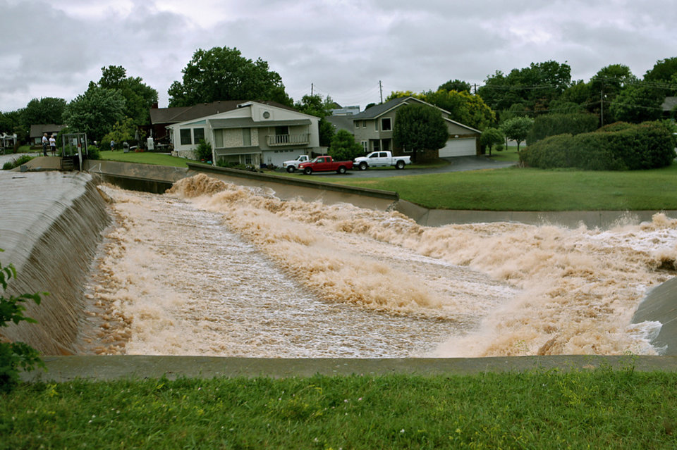 Photo - Water spills over the dam in the Ski Island neighborhood of Hefner between Macarthur and Rockwell in Oklahoma City on Monday, June 14, 2010. Photo by John Clanton, The Oklahoman