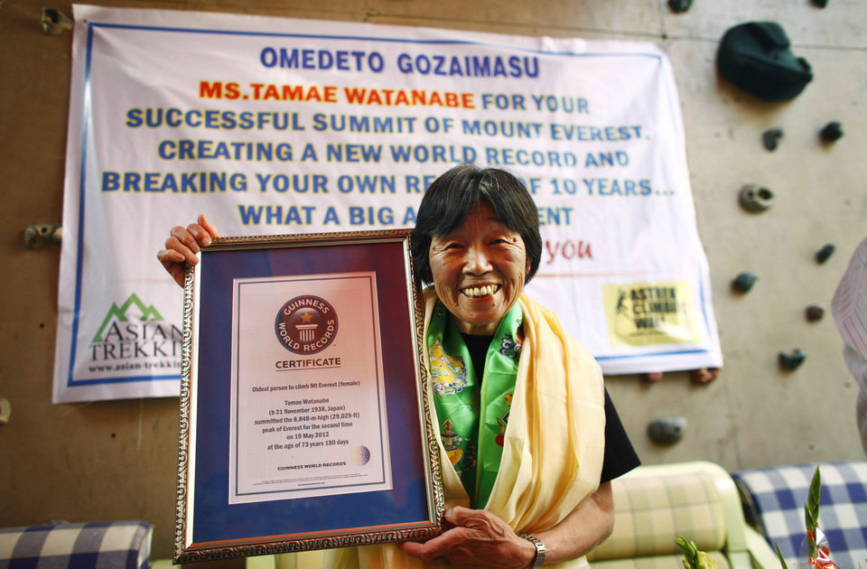 Photo -   Japanese climber Tamae Watanabe poses with a replica of the Guinness World Record certificate during a press conference organized by the Asian Trekking to felicitate her in Katmandu, Friday, May 25. 2012. Watanabe, 73, has made history by becoming the oldest woman to scale the world's highest mountain, Mount Everest, bettering a record, she herself set a decade ago. (AP Photo/Niranjan Shrestha)