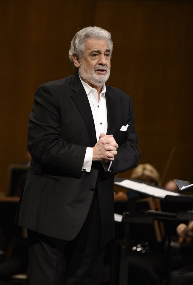 Photo - FILE - In this June 7, 2013 file photo, tenor Placido Domingo performs at the Dorothy Chandler Pavilion in Los Angeles. Domingo is in the hospital after suffering a blockage in an artery of the lungs. Domingo's publicist says the 72-year-old is expected to make a full recovery but will have to miss at least two appearances scheduled for later this month. He was admitted to the hospital Monday, July 8, 2013, in Madrid. (Photo by Dan Steinberg/Invision/AP, File)
