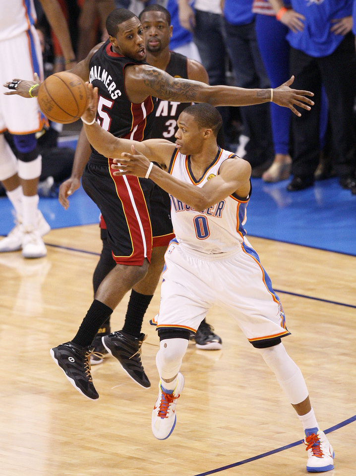 Oklahoma City's Russell Westbrook (0) passes the ball past Miami's Mario Chalmers (15) during Game 2 of the NBA Finals between the Oklahoma City Thunder and the Miami Heat at Chesapeake Energy Arena in Oklahoma City, Thursday, June 14, 2012. Photo by Nate Billings, The Oklahoman