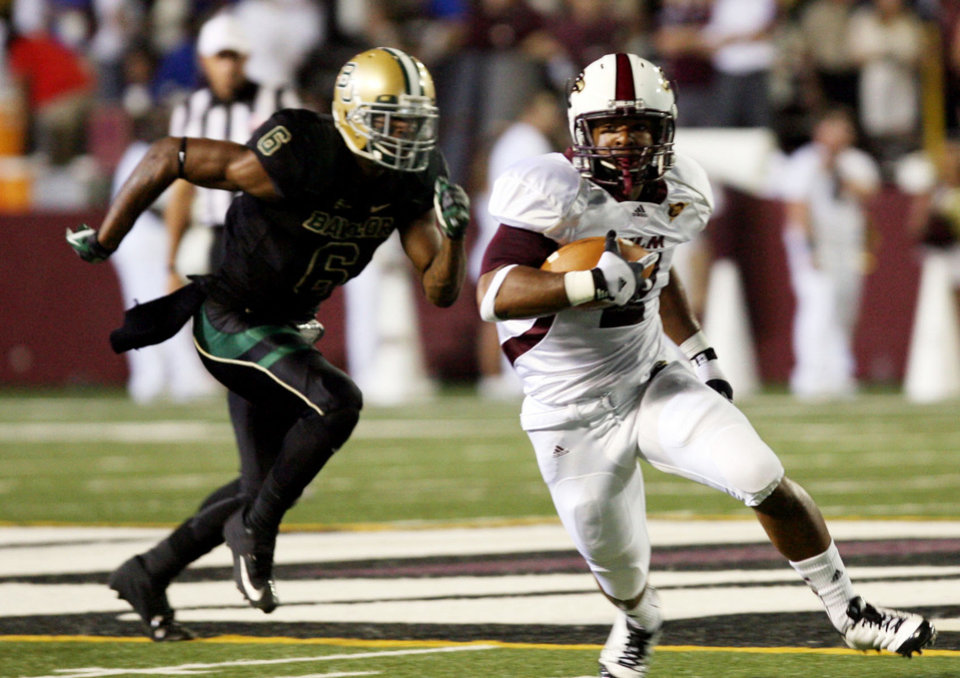 Photo -   Baylor's Ahmad Dixon (6) tries to tackle Louisiana-Monroe's Monterrell Washington (2) during an NCAA college football game Friday, Sept. 21, 2012, in Monroe, La. (AP Photo/The News-Star, Arely D. Castillo)