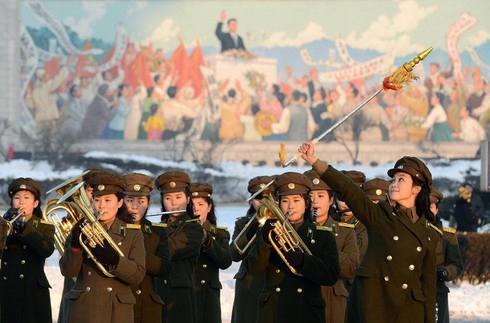 Photo - Female members of a North Korean military band perform in celebration of the country's rocket launch in Pyongyang, North Korea Wednesday, Dec. 12, 2012. North Korea successfully fired a long-range rocket on Wednesday, defying international warnings as the regime of Kim Jong Un took a big step forward in its quest to develop a nuclear missile. (AP Photo/Kyodo News) JAPAN OUT, MANDATORY CREDIT, NO LICENSING IN CHINA, FRANCE, HONG KONG, JAPAN AND SOUTH KOREA ORG XMIT: TOK815