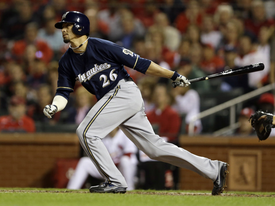Photo - Milwaukee Brewers' Kyle Lohse watches his two-run single during the fourth inning of a baseball game against the St. Louis Cardinals, Tuesday, April 29, 2014, in St. Louis. (AP Photo/Jeff Roberson)