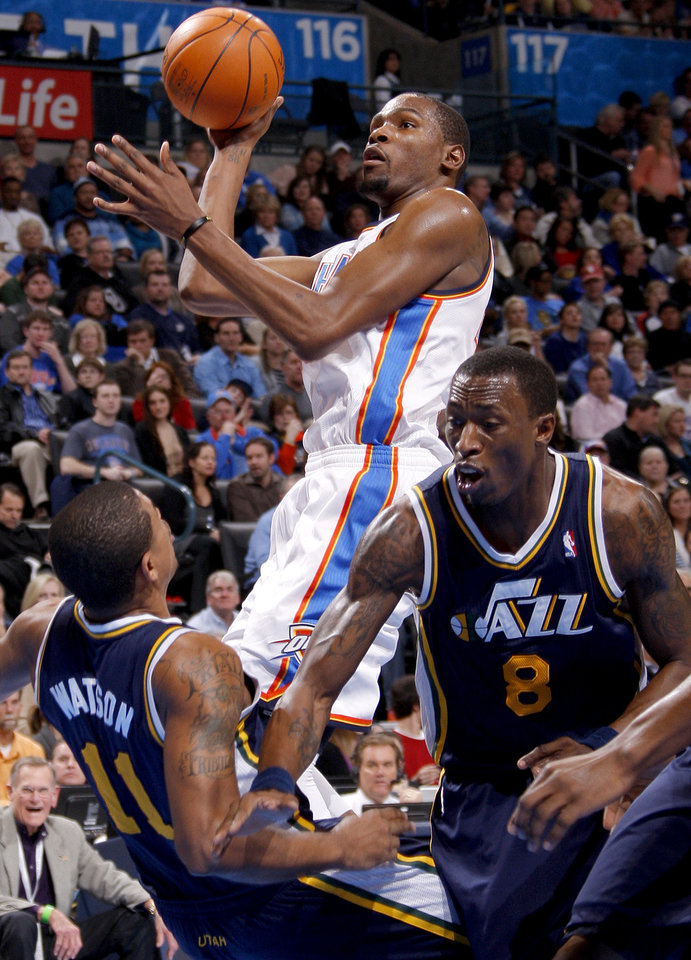 Oklahoma City\'s Kevin Durant (35) goes to the basket between Utah\'s Earl Watson (11) and Josh Howard (8) during an NBA game between the Oklahoma City Thunder and the Utah Jazz at Chesapeake Energy Arena in Oklahoma CIty, Tuesday, Feb. 14, 2012. Photo by Bryan Terry, The Oklahoman