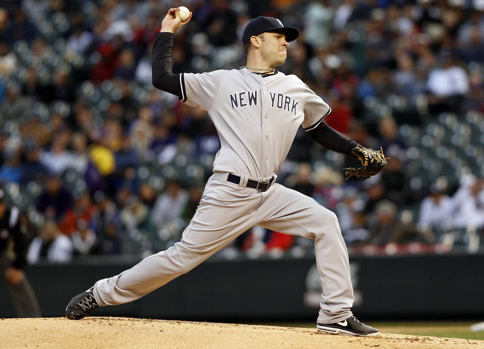 New York Yankees starting pitcher David Phelps delivers against the Colorado Rockies in the first inning of a baseball game in Denver on Wednesday, May 8, 2013. (AP Photo/David Zalubowski)