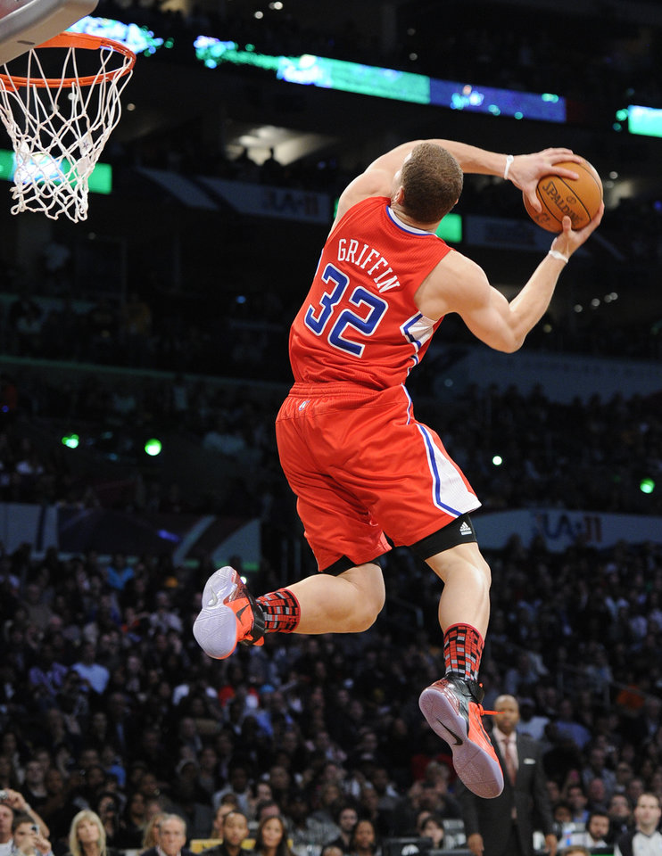 Photo -  Los Angeles Clippers' Blake Griffin twists as he dunks during the Slam Dunk Contest at the NBA basketball All-Star Saturday Night, Saturday, Feb. 19, 2011, in Los Angeles.  (AP Photo/Mark J. Terrill)