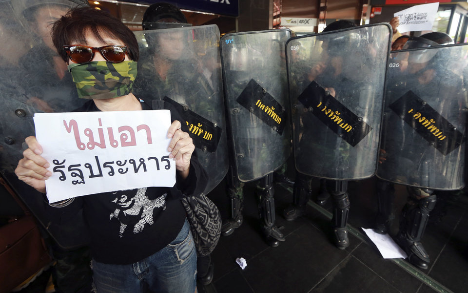 Photo - A Thai demonstrator shows a banner that reads