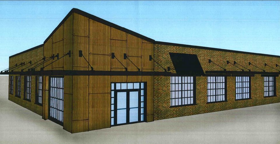 A non-descript brick warehouse at the entry to Film Row will be renovated and turned into offices  for Douglas Sorocco as shown in this rendering. <strong>Design Build Group</strong>