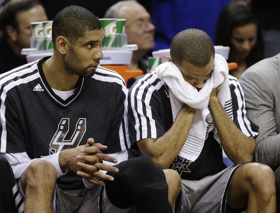 San Antonio Spurs' Tim Duncan, left, and Tony Parker, right, react against the Golden State Warriors during the second half in Game 2 of a Western Conference semifinal NBA basketball playoff series, Wednesday, May 8, 2013, in San Antonio. Golden State won 100-91.(AP Photo/Eric Gay)
