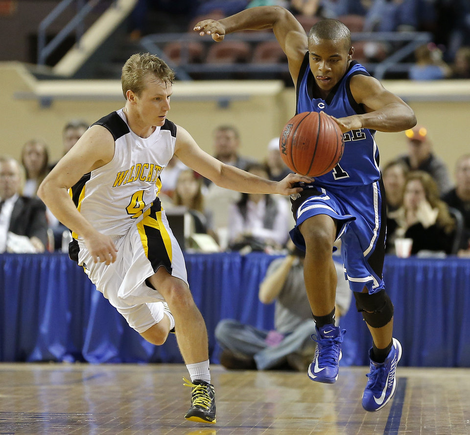 Photo - Coyle's Lashay Johnson tries to stay in bounds beside Arnett's Taylor Coburn during the Class B boys state championship game between Coyle and Arnett in the State Fair Arena at State Fair Park in Oklahoma City, Saturday, March 2, 2013. Photo by Bryan Terry, The Oklahoman