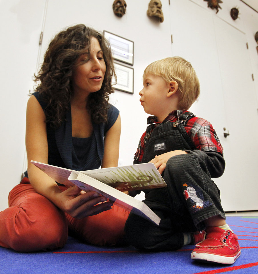 Francesca Giani and son Peter Basey read a children's book during Art Adventures at the Fred Jones Jr. Museum of Art on the campus of the University of Oklahoma (OU) on Tuesday, Sept. 18, 2012 in Norman, Okla.  Photo by Steve Sisney, The Oklahoman