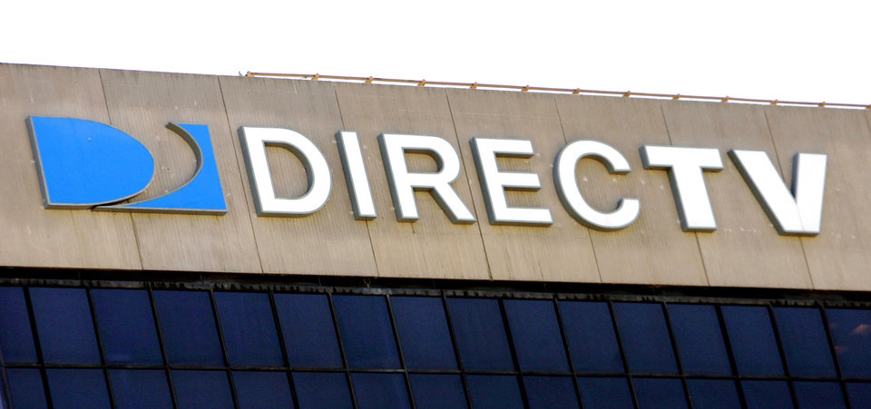 Photo - File- This Aug. 8, 2006 file photo shows the DirecTV building in El Segundo, Calif.  AT&T says it is buying DirecTV for $95 per share, or $49 billion, a move that gives the telecommunications company a larger base of video subscribers and increases its ability to compete against Comcast and Time Warner Cable, which agreed to a merger in February.  (AP Photo/Reed Saxon, File)
