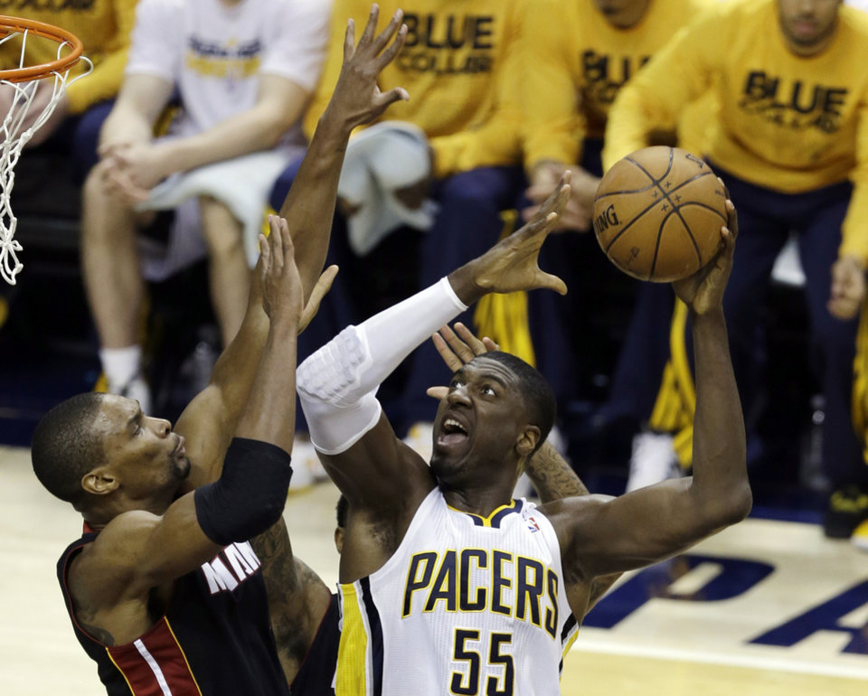 Indiana Pacers\' Roy Hibbert (55) shoots against Miami Heat\'s Chris Bosh during the first half of Game 3 of the NBA Eastern Conference basketball finals in Indianapolis, Sunday, May 26, 2013. (AP Photo/Michael Conroy)