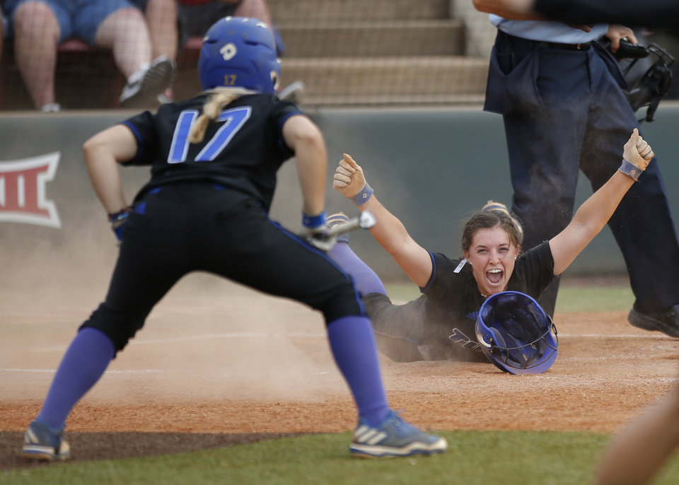 Photo -  Tulsa's Tori Stafford, right, celebrates a score in the 10th inning as Tulsa's Morgan Neal looks on during the NCAA Norman Regional on Sunday. OU won 6-4 in the tenth inning. [Photo by Sarah Phipps, The Oklahoman]
