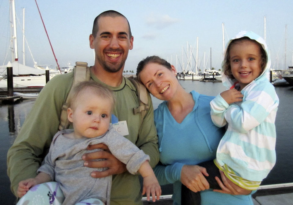 Photo - FILE - This undated file image provided by Sariah English shows Eric and Charlotte Kaufman with their daughters, Lyra, 1, and Cora, 3. None of the three federal agencies that helped rescue the ill 1-year-old and her family from their broken down sailboat about 900 miles off Mexico's Pacific coast plan to seek reimbursement for the cost of the operation. Officials from the Navy, Coast Guard and California Air National Guard said Tuesday, April 8, 2014, they don't charge for search-and-rescue missions.