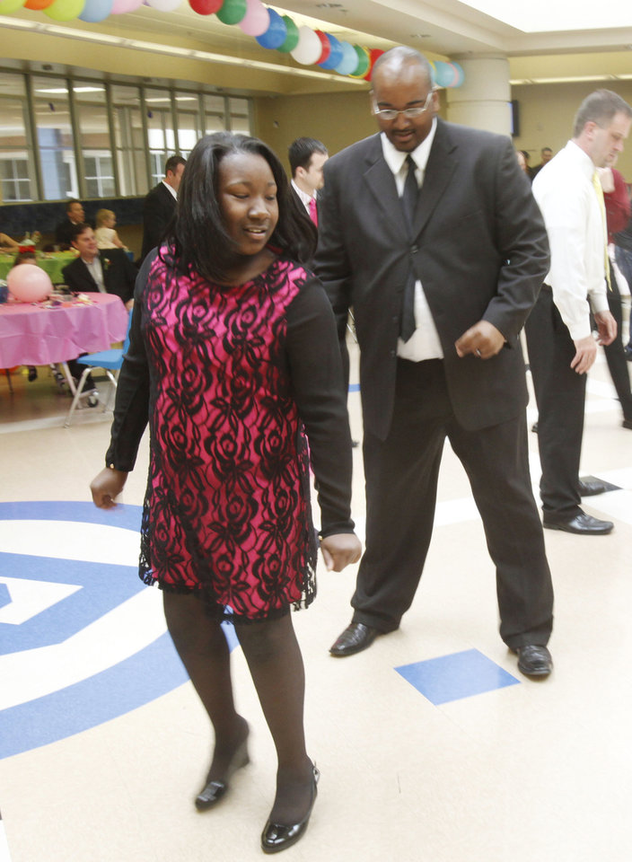 Philip Nolan and Toni Davis share a dance during the Deer Creek Daddy daughter dance at Deer Creek High School in Oklahoma City, OK, Saturday, January 26, 2013,  By Paul Hellstern, The Oklahoman